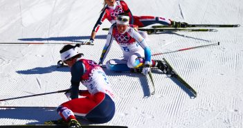 SOCHI, RUSSIA - FEBRUARY 08:  Marit Bjoergen (bottom) of Norway, Charlotte Kalla (C) of Sweden and Therese Johaug of Norway collapse on the snow after competing in the Ladies' Skiathlon 7.5 km Classic + 7.5 km Free during day one of the Sochi 2014 Winter Olympics at Laura Cross-country Ski & Biathlon Center on February 8, 2014 in Sochi, Russia.  (Photo by Clive Mason/Getty Images) ORG XMIT: 461588377